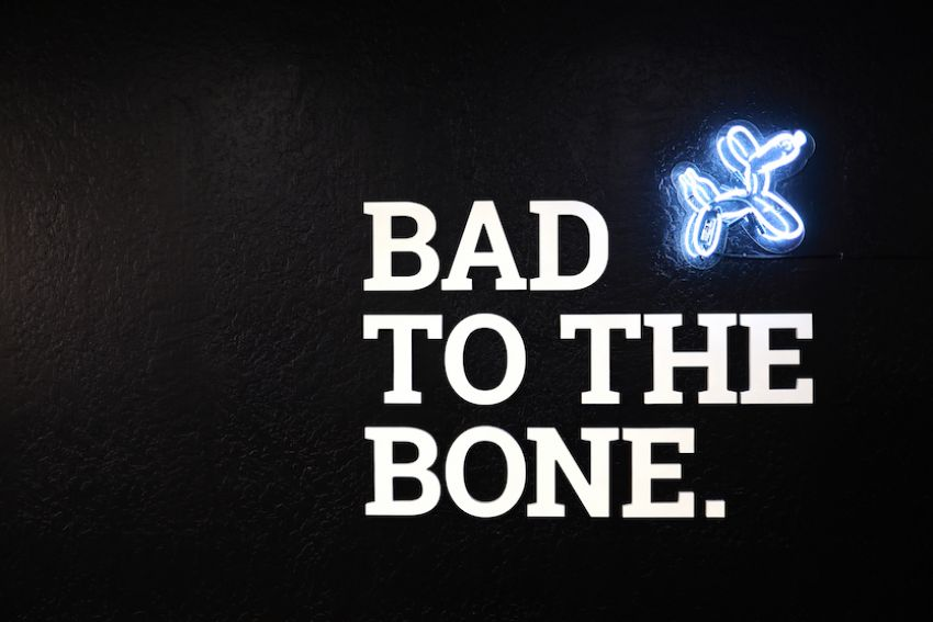 bad to the bone white letters on black wall
