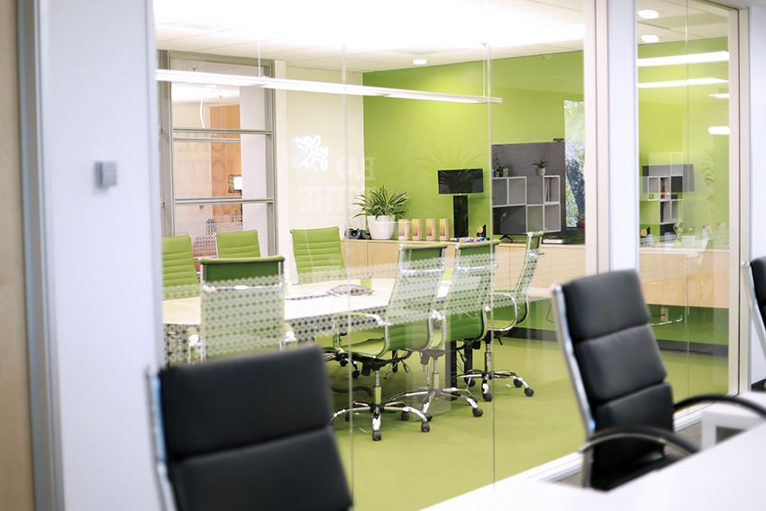 green conference room wall of glass panels